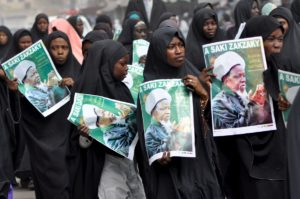 Shiites walk along a street during a protest calling for the release of their leader Malam El-Zakzaky in Kano, Nigeria, December 21, 2015 REUTERS/Stringer EDITORIAL USE ONLY. NO RESALES. NO ARCHIVE - RTX1ZNKV